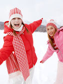 Two girls playing games and having fun in in winter — Стоковое фото