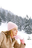 Woman on the snow mountains — Stock Photo