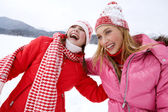 Two young women in winter outdoors — Stok fotoğraf