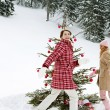 Girls around Christmas tree — Stock Photo #42540047
