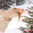 Girls around Christmas tree — Stock Photo