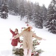 Girls around Christmas tree — Stock Photo #42540789