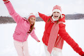 Two girls playing games and having fun in in winter — Stock Photo