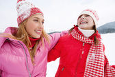 Two young women in winter outdoors — ストック写真