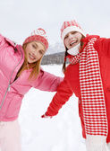 Two girls playing games and having fun in in winter — Foto de Stock