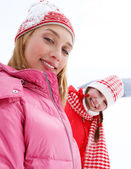 Two young women in winter outdoors — Stockfoto