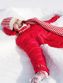 Woman laying down on the snow — Stok fotoğraf