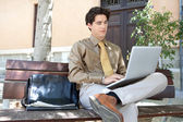 Businessman using his laptop outdoors — Stock Photo