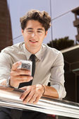 Businessman using a smart phone — Stock Photo