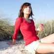 Woman sitting on a beach — Stock Photo