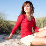 Woman sitting on a beach — Stock Photo