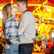 Couple standing by carousel — Stock Photo