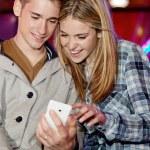 Young teenage couple sitting — Stock Photo #43518465