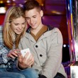 Young teenage couple sitting — Stock Photo