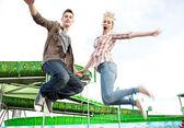 Teenage couple holding hands — Stock Photo
