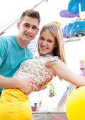 Couple visiting fun fair — Stock Photo
