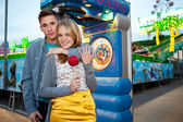 Couple visiting a funfair — Stock Photo
