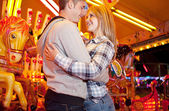 Couple visiting  amusement park — Stock Photo