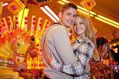 Couple visiting  amusement park — Stock Photo