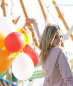 Teenage girl in an amusement park — Stock Photo