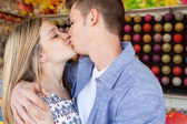 Attractive young couple kissing — Stock Photo