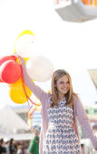 Teenage girl holding balloons — Stock Photo