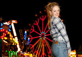 Teenage girl visiting a funfair — Stock Photo