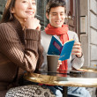 Couple sitting at cafe — Stock Photo #44205355