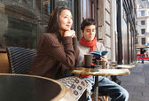 Couple sitting at  cafe — Stok fotoğraf