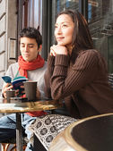Couple sitting at  cafe — Stock Photo