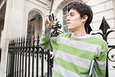 Man using digital camera — Stock Photo
