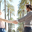 Постер, плакат: Couple in palm trees boulevard