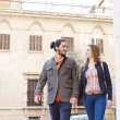Couple walking passed buildings — Stock Photo #45065613