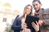Couple  sharing  digital tablet — Stock Photo