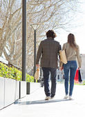 Couple holding walking together — Stock Photo