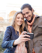 Couple taking a picture — Stock Photo