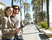 Couple on  palm trees boulevard — Stock Photo