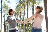 Couple in  palm trees boulevard — Stock Photo