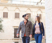 Couple walking passed buildings — Stock Photo