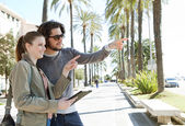 Couple on  palm trees boulevard — Stock Photo