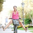 Woman  riding a bike — Stock Photo #45207099