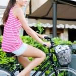 Woman riding a bike — Stock Photo #45207107