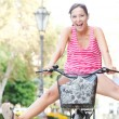 Woman  riding a bike — Stock Photo #45207109