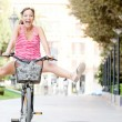 Woman  riding a bike — Stock Photo #45207311