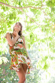 Woman standing in  tropical forest — Stock Photo