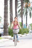 Woman riding a bycicle — Stock Photo