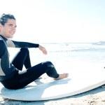 Surfer man sitting down — Stock Photo #45812589