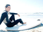Surfer man sitting down — Stock Photo