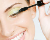 Woman wearing green eyeshadow — Stock Photo