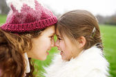 Sisters rubbing noses together — Stock Photo
